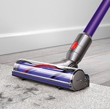 V8 Absolute cord-free vacuu cleaning floors with soft roller cleaner head